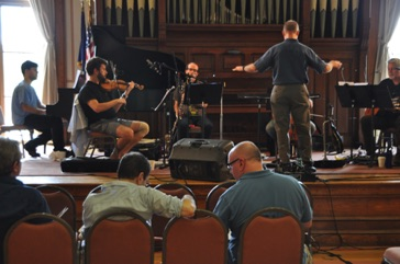 "Conferring with composer Roger Zahab during a rehearsal of ""Divinitus"" at VCFA August 2013"
