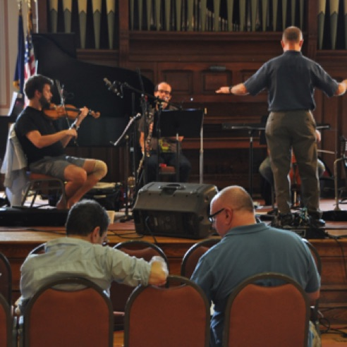 "Conferring with composer Roger Zahab during a rehearsal of ""Divinitus"" at VCFA (August 2013)"