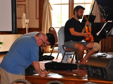 "Consulting with pianist Stephen Gosling during a rehearsal of ""Divinitus"" August 2013"
