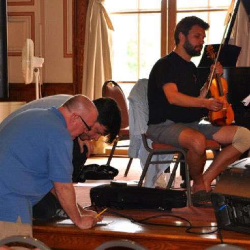 "Consulting with pianist Stephen Gosling during a rehearsal of ""Divinitus""  (August 2013)"