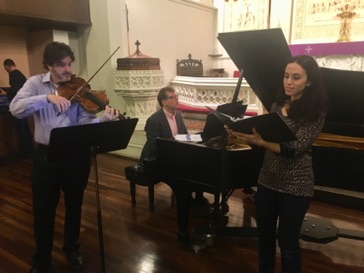 "Soprano Lauren Ishida, pianist Chris Sahar and violist Artie Gibble rehearsing ""The Bird Lady"" prior to the premiere."